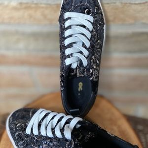Aldo sneakers in good condition.  Black and gold
